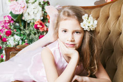Little girl lying on the couch Royalty Free Stock Image