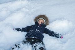 Girl lying in a deep snow stock images