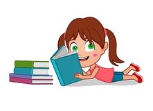 Young Girl lying reading a book. Little girl lying down reading an open book smiling Stock Photography
