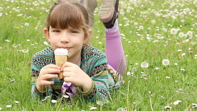 Little girl lying and eat ice cream stock footage