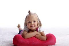Little girl lying on the floor Stock Photo