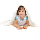 little girl lying on the floor Stock Photography