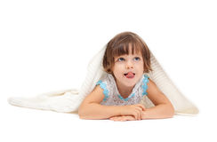 Little girl lying on the floor Royalty Free Stock Image