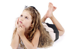 Little girl lying on the floor and dreaming Royalty Free Stock Images