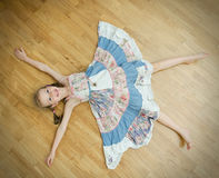 Little girl lying on the floor Royalty Free Stock Photo