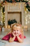 Little girl lying on the floor Stock Photos