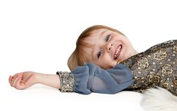 Little girl lying on the floor in the studio Royalty Free Stock Photos