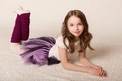Little girl lying on floor Royalty Free Stock Images
