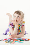 Little girl lying on the floor and thinking Royalty Free Stock Photos