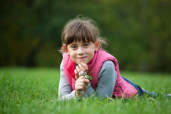 Little girl lying on the grass Royalty Free Stock Photo