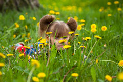 Little girl lying in grass Royalty Free Stock Photography