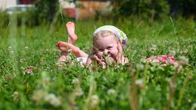 Little girl lying on the grass stock video
