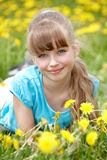 Little girl lying on grass in flower. stock photography