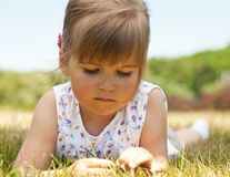 Little girl lying on grass in the park Royalty Free Stock Photos