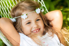 Little girl lying on hammock. Happy little girl lying on hammock Stock Image