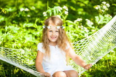 Little girl lying on hammock. Happy little girl lying on hammock Royalty Free Stock Images