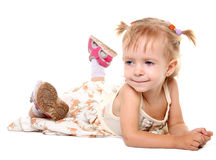Little girl lying on her stomach Royalty Free Stock Photos