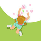 Little girl lying on her stomach and painting flowers with her hands, top view of child on the floor royalty free illustration