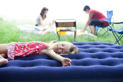 Little girl lying on an inflatable mattress Royalty Free Stock Image