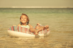 Little girl  lying on the  inflatable rubber circle  in the sea Stock Photography
