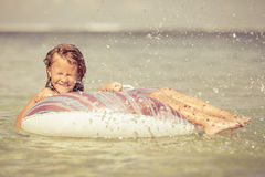 Little girl  lying on the  inflatable rubber circle  in the sea Royalty Free Stock Photos