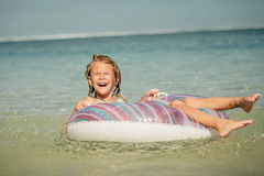 Little girl  lying on the  inflatable rubber circle  in the sea Royalty Free Stock Images
