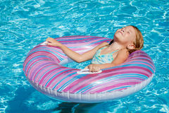 Little girl lying on the  inflatable rubber circle Stock Image