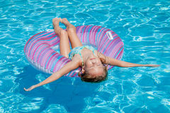 Little girl lying on the  inflatable rubber circle Stock Photos