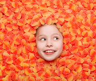 Little girl lying in jellies stock photos
