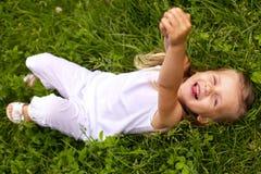 Free Little Girl Lying On Grass Stock Images - 14644544