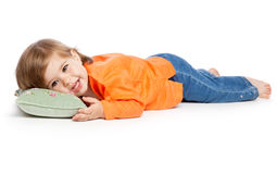 Little girl lying on the pillow. Isolated on white background royalty free stock image