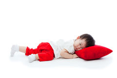 Little girl lying on red pillow Stock Photography