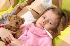 Little girl lying sick. In bed royalty free stock image