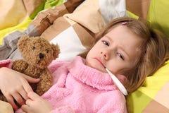 Little Girl Lying Sick Royalty Free Stock Image