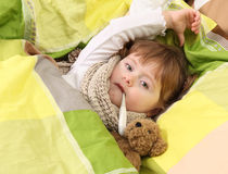 Little girl lying sick Royalty Free Stock Photography