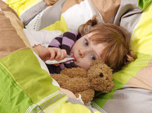 Little girl lying sick. Little girl sick in bed royalty free stock photo