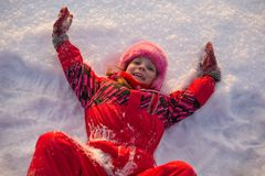 Little girl lying in the snow Royalty Free Stock Photography