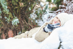 Little girl lying in the snow Royalty Free Stock Image