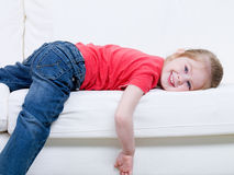Little girl lying on the sofa Stock Photo