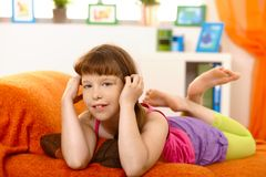 Little girl lying on sofa Royalty Free Stock Photos