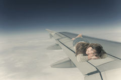 Little girl is lying on the wing of an aircraft Stock Image