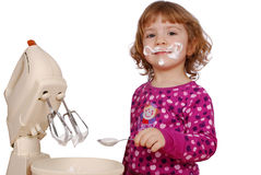 Little girl made cream for cake Stock Image