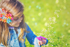 Little girl with magic butterfly royalty free stock image