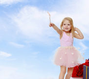 Little girl with a magic wand. Royalty Free Stock Photo