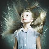 Little girl with magnificent hair Stock Image