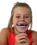 Little girl with magnifier Stock Photography