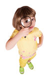 Little girl with magnifying glass stock image
