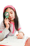 Little girl magnifying glass and book royalty free stock images