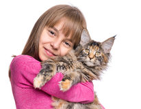 Little girl with Maine Coon kitten. Happy little girl hugging lovely kitten. Cute ten year old child playing with her cat, isolated on white background. Portrait Royalty Free Stock Photography