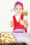Little girl make and eat croissant Royalty Free Stock Image